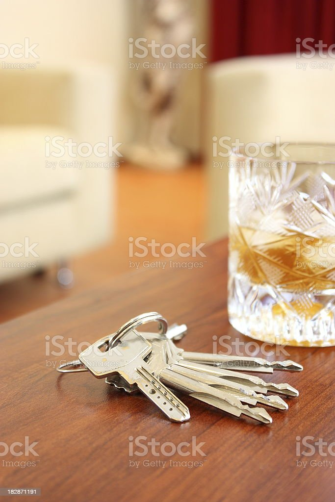 Beverages and house key royalty-free stock photo