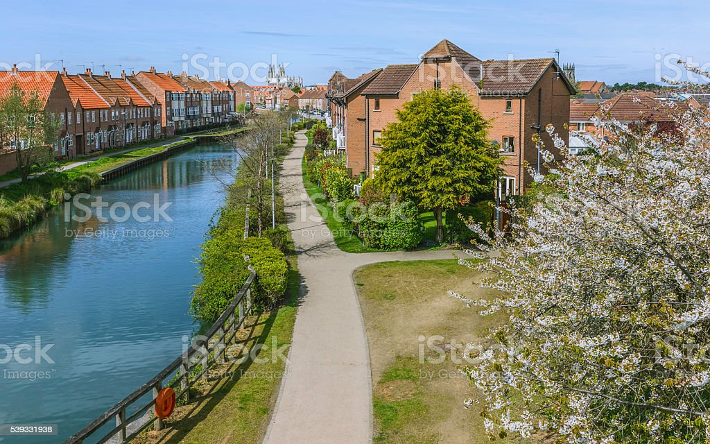Beverley minster and beck with  town houses, Yorkshire, UK. stock photo