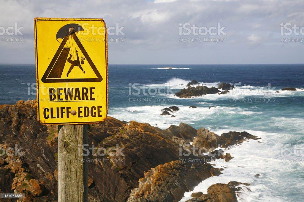 Beware Cliff Edge danger sign royalty-free stock photo