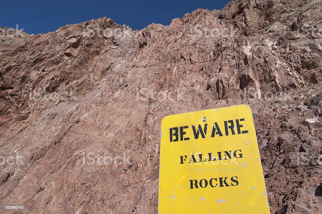 Beware Falling Rocks stock photo