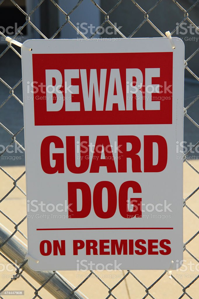 Beware Guard Dog Sign Caution stock photo