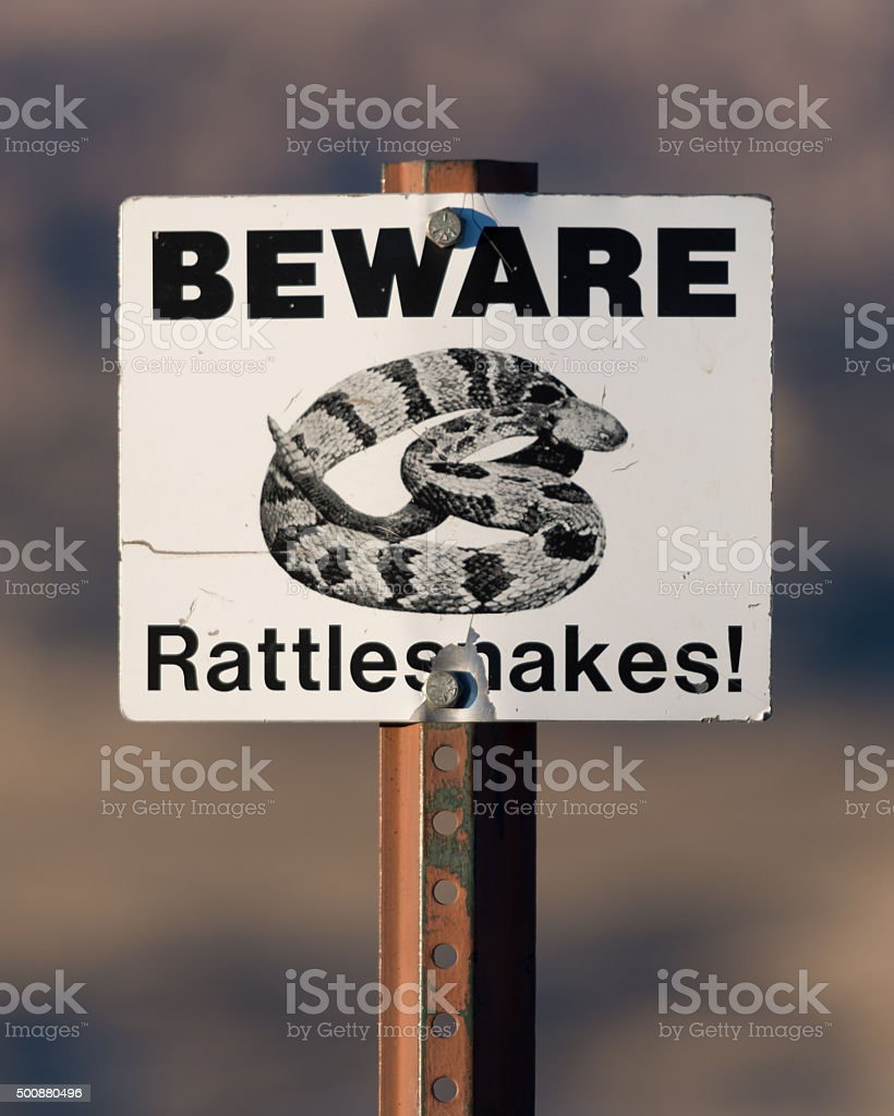 Beware of Rattlesnakes Sign stock photo