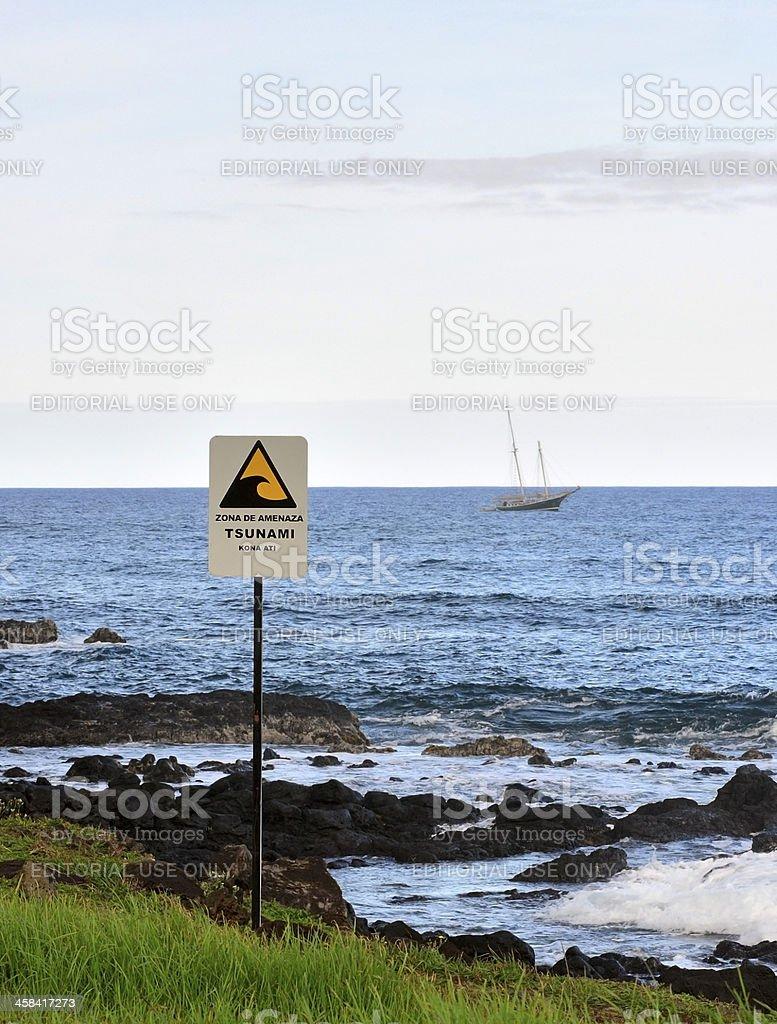 Beware of Tsunami sign on the Pacific Ocean shoreline royalty-free stock photo