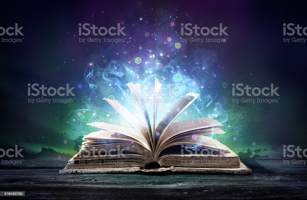 Bewitched Book With Magic Glows In The Darkness stock photo
