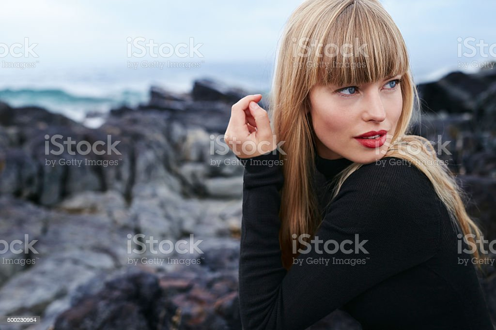 Bewitching young woman in black stock photo