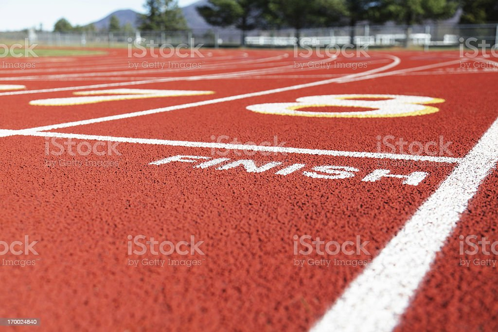 Beyond the Finish Line on Red Running Race Track stock photo