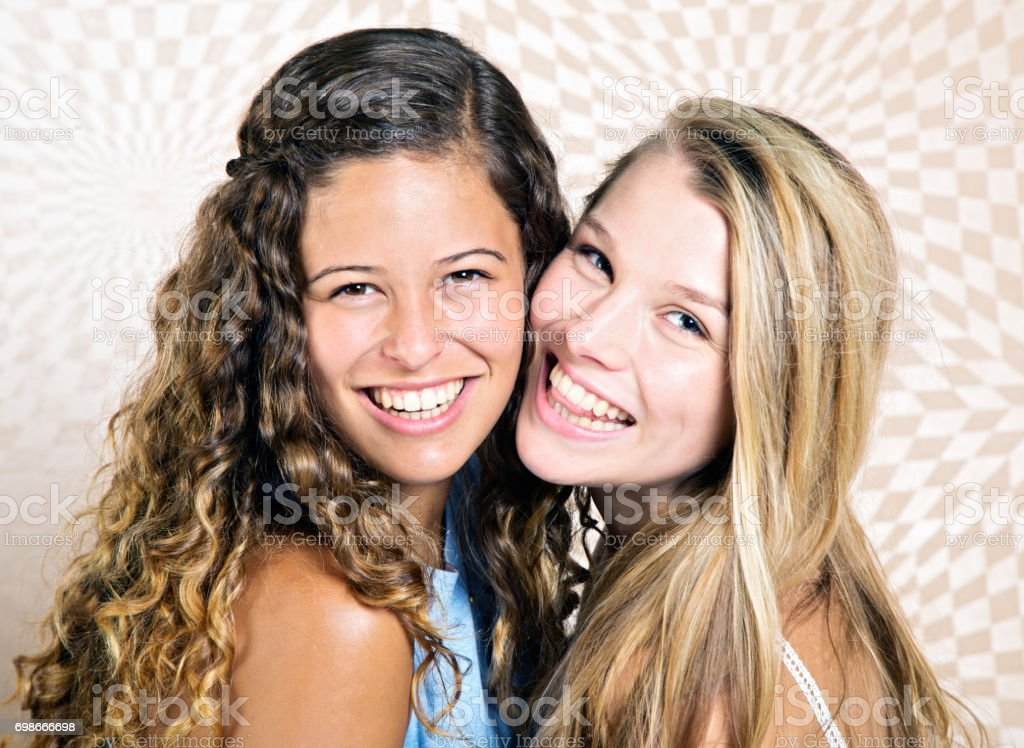 BFFs, two pretty girlfriends smile brightly stock photo