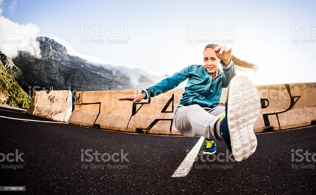 B-girl teen keeping fit by breakdancing for sport stock photo