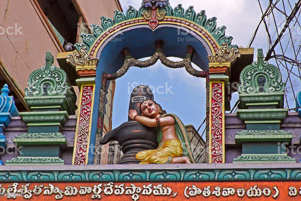 Bhakta hugs Shiva-Lingam stock photo