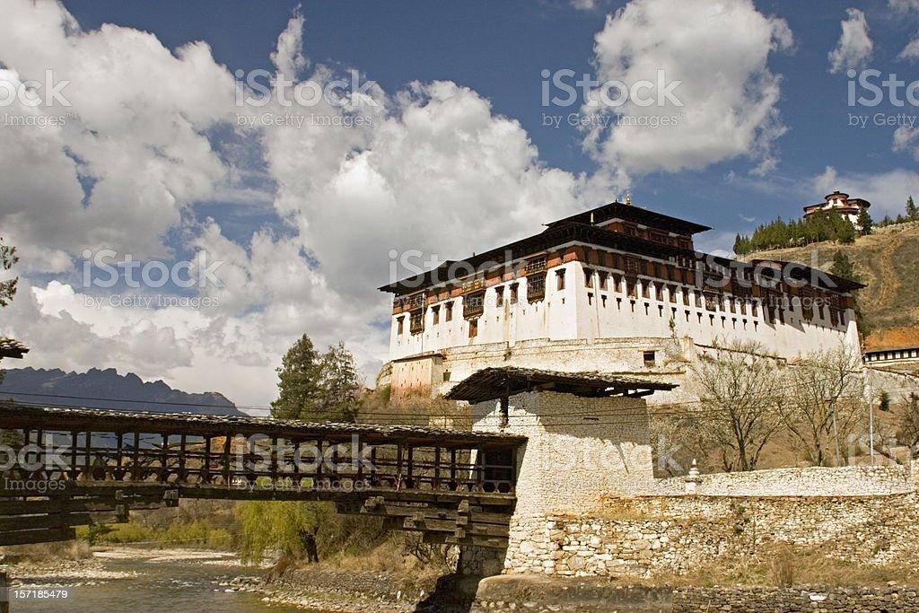 Bhutan - Dzong and Bridge over Stream stock photo