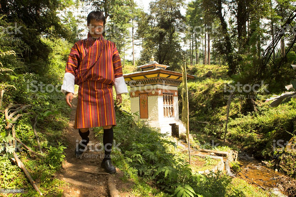 Bhutanese man and temple stock photo