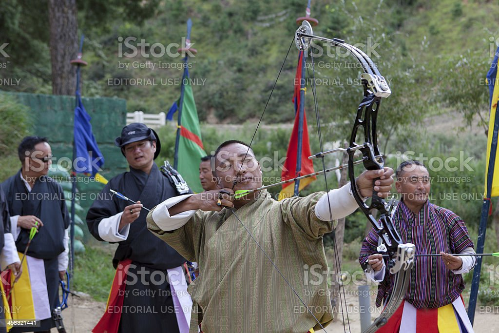 Bhutanese men compete in game of archery stock photo