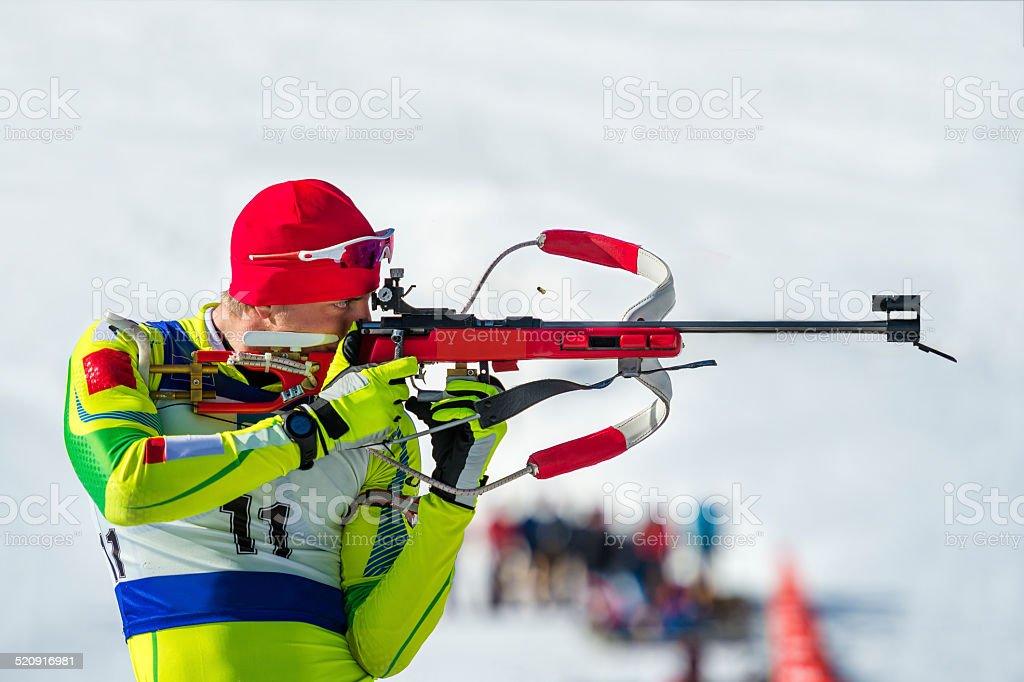 Biathlon competitor at shooting range stock photo