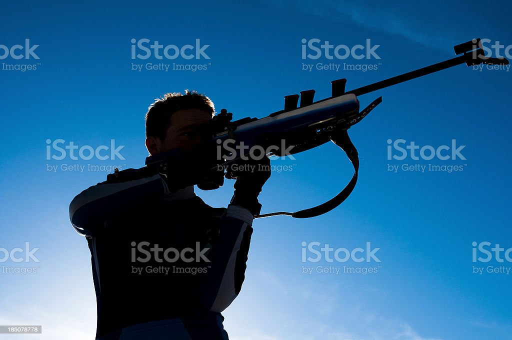 Biathlon competitor during shooting stock photo