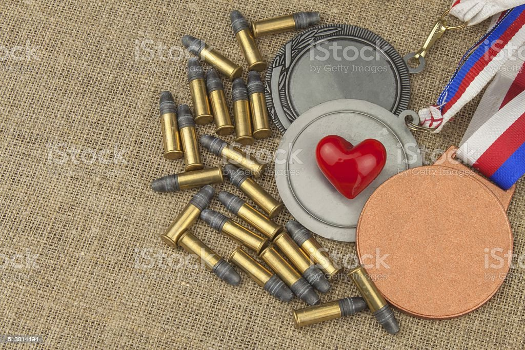 Biathlon victory. Ammunition and winners medals in biathlon stock photo