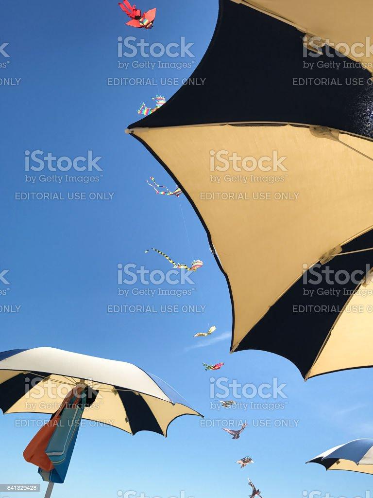 Bibione - Kites and umbrellas stock photo