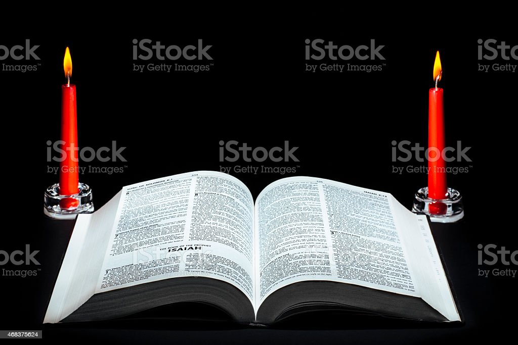 Bible and burning candles for Easter stock photo