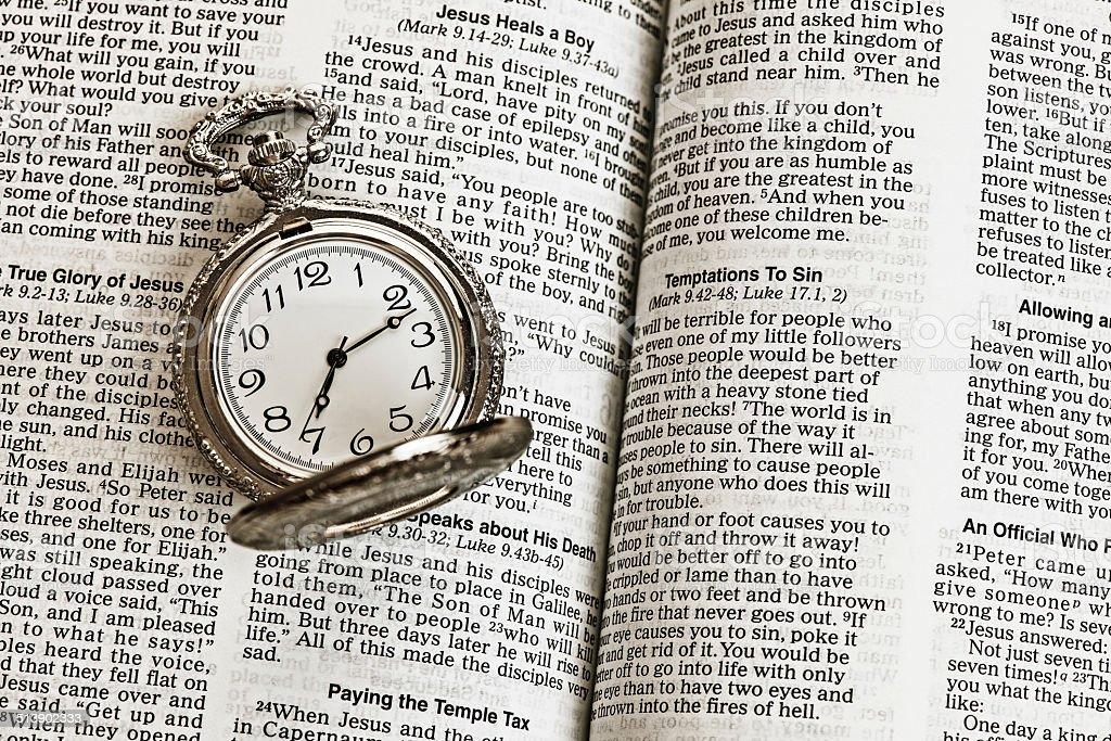 Bible and Clock stock photo