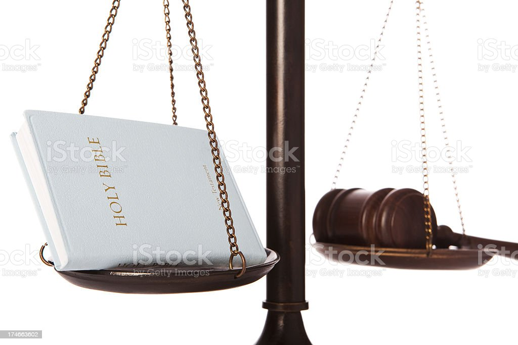 Bible and gavel on scale stock photo
