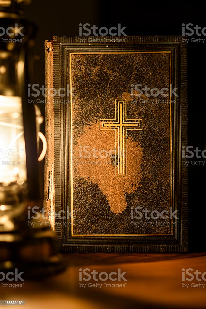 Bible and Oil Lamp stock photo
