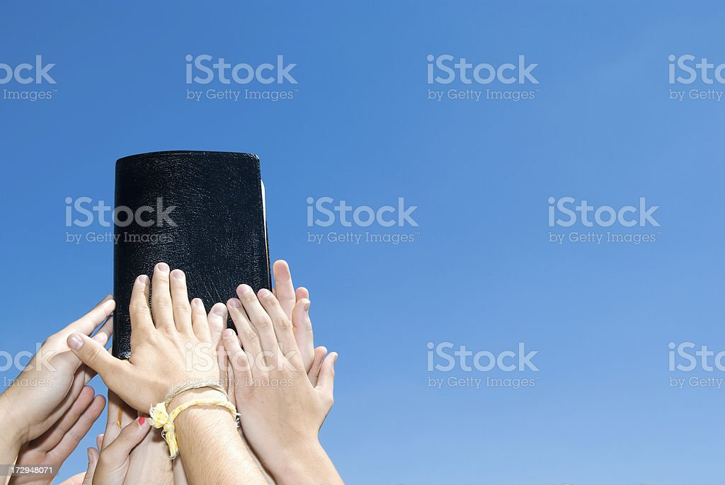 Bible and Youth Group Hands royalty-free stock photo
