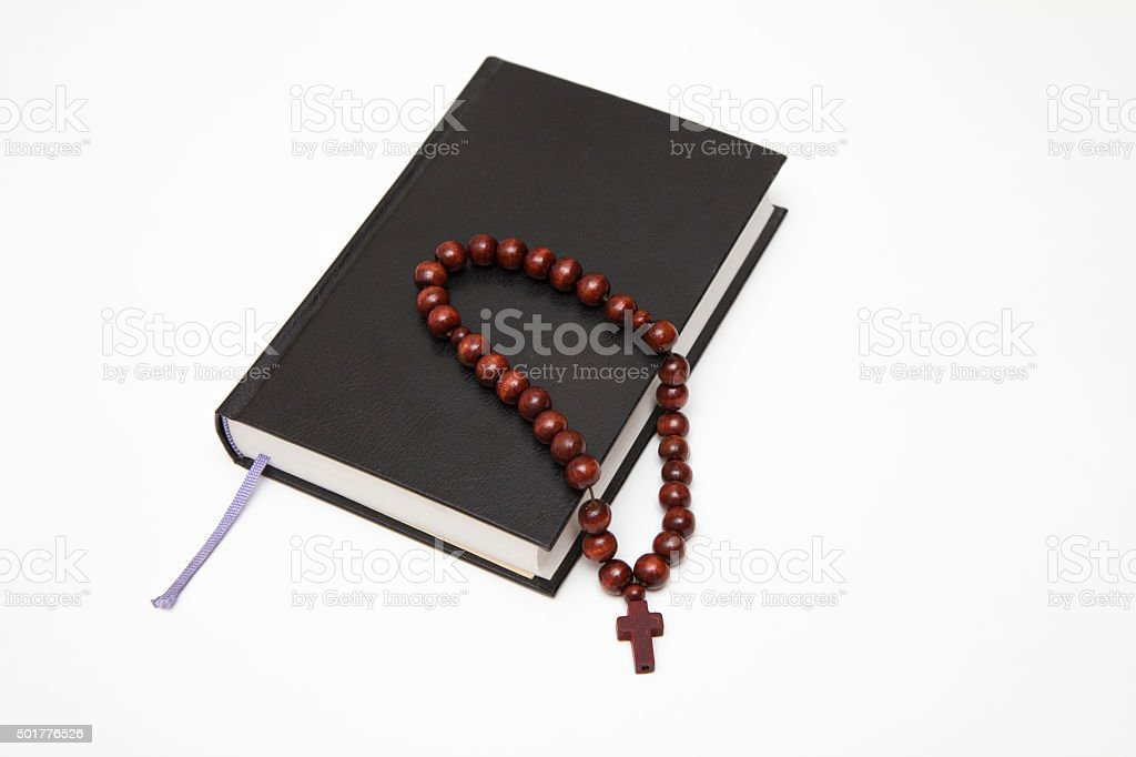 bible book and rosary  on white stock photo