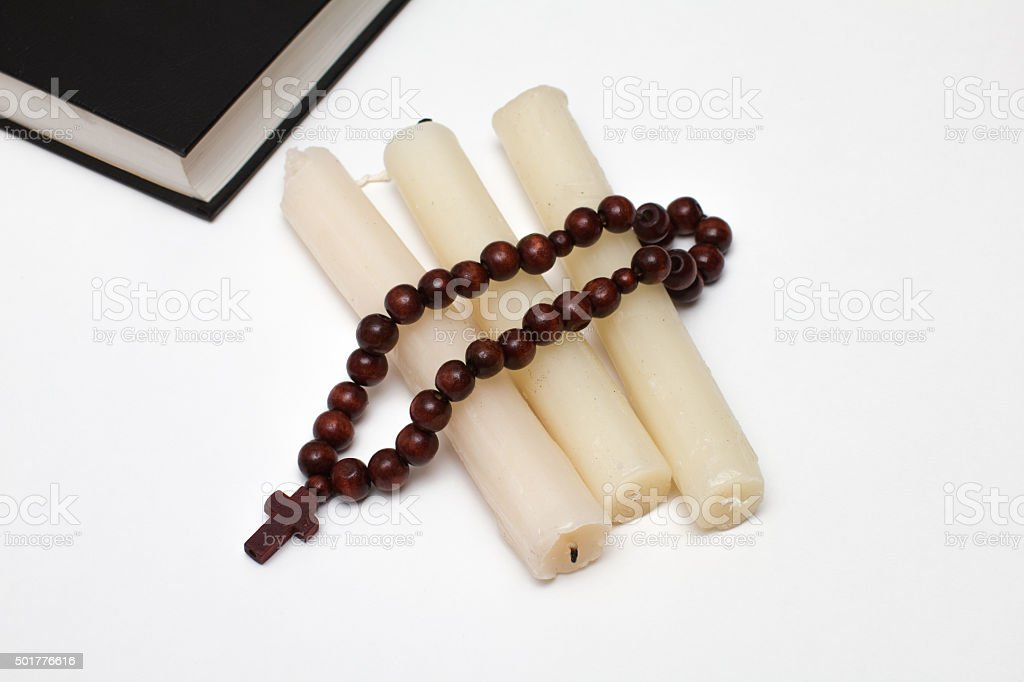 bible book and rosary with three candle stock photo