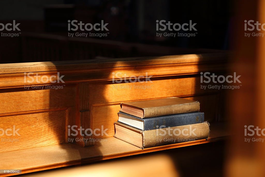 Bible book in the sunny church stock photo