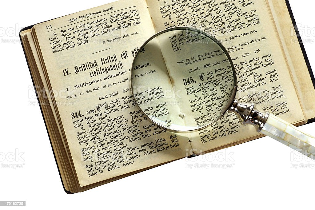 bible book with hand lens royalty-free stock photo