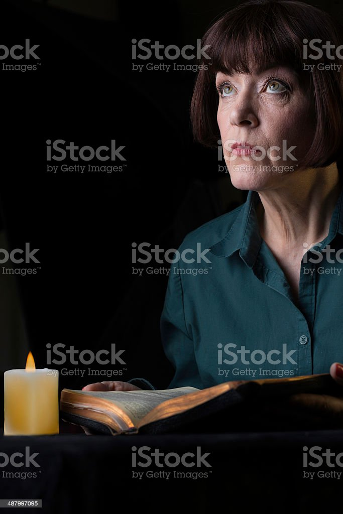 Bible by candlelight royalty-free stock photo