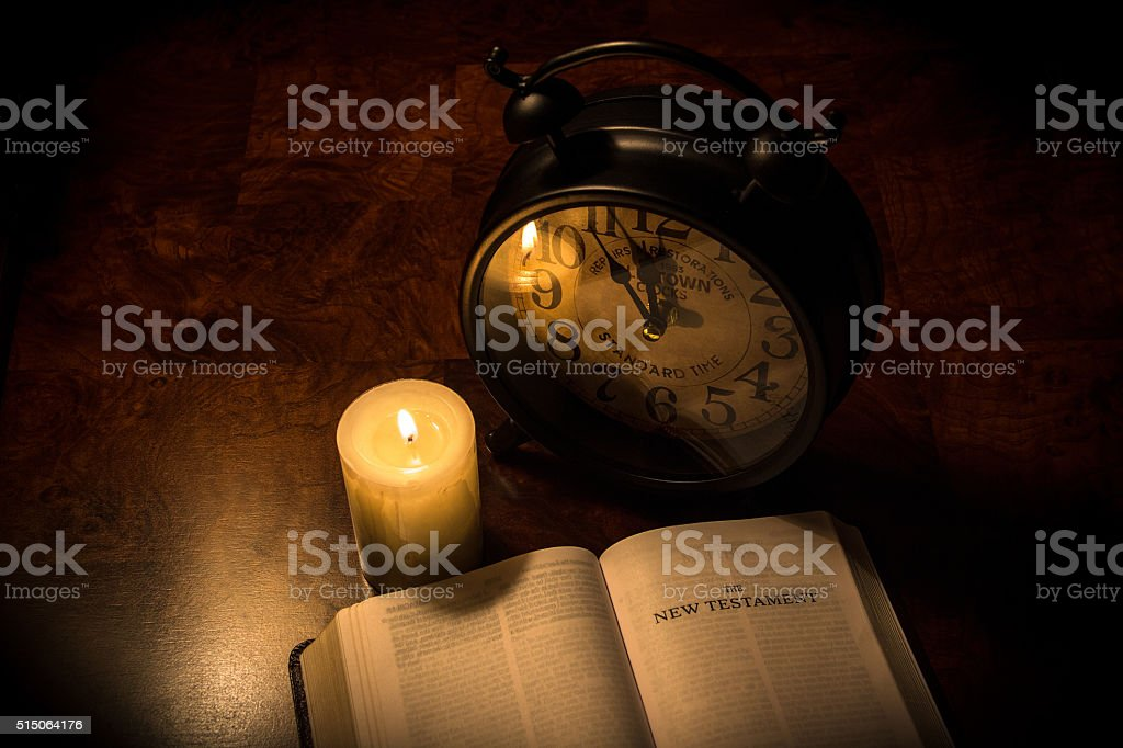 Bible & candle stock photo
