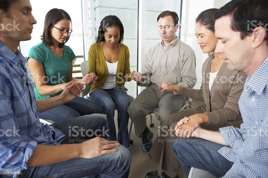 Bible Group Praying Together stock photo