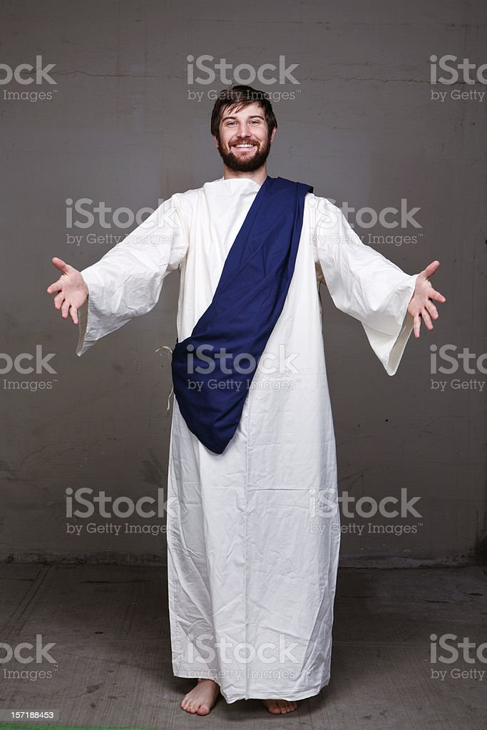 Bible Guy Holding Hands Out and Smiling stock photo
