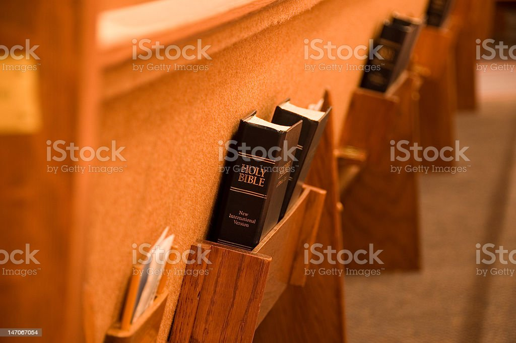 Bible in a pew stock photo