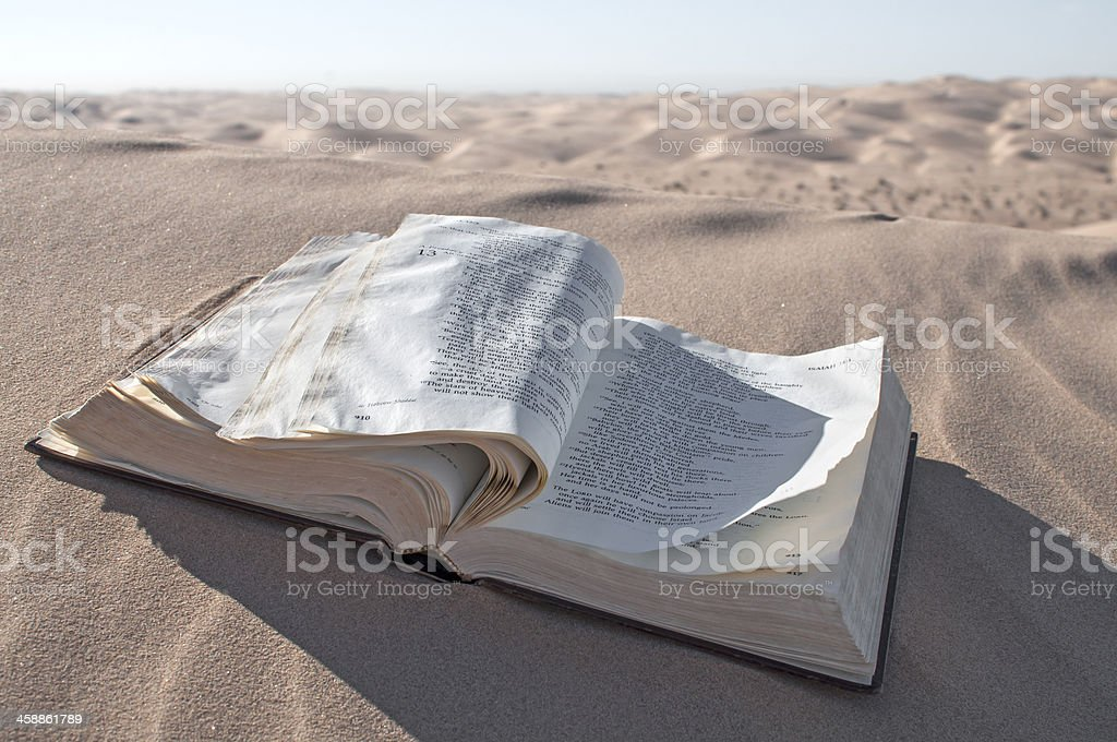 Bible in desert stock photo