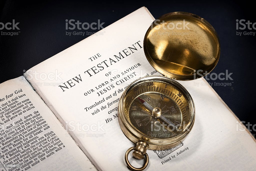Bible New Testament with brass compass stock photo