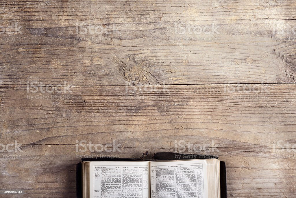 Bible on a wooden desk stock photo