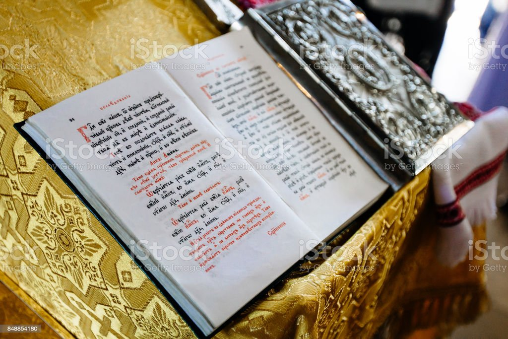 bible on reading-desk or lectern, sacred lectern in the church decorated with golden friezes and ornaments stock photo