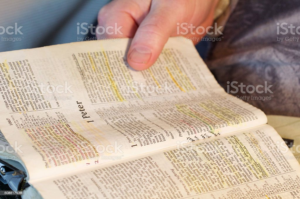 Bible Opened to 1 Peter stock photo