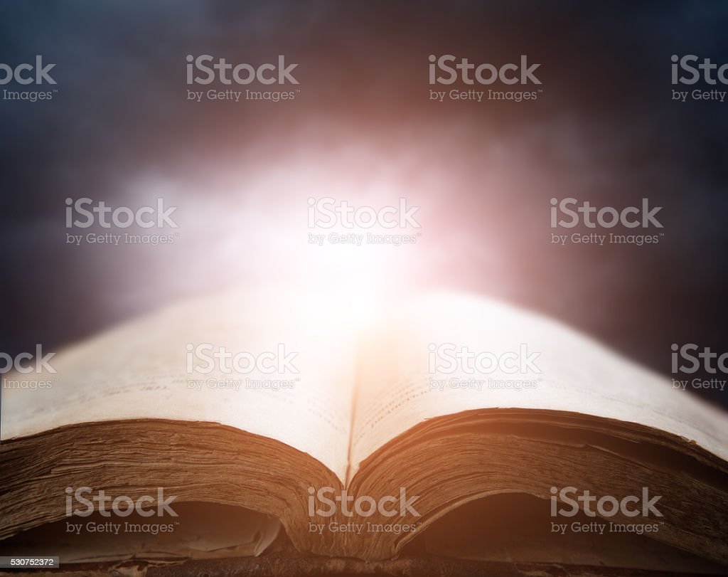bible over sunset sky stock photo