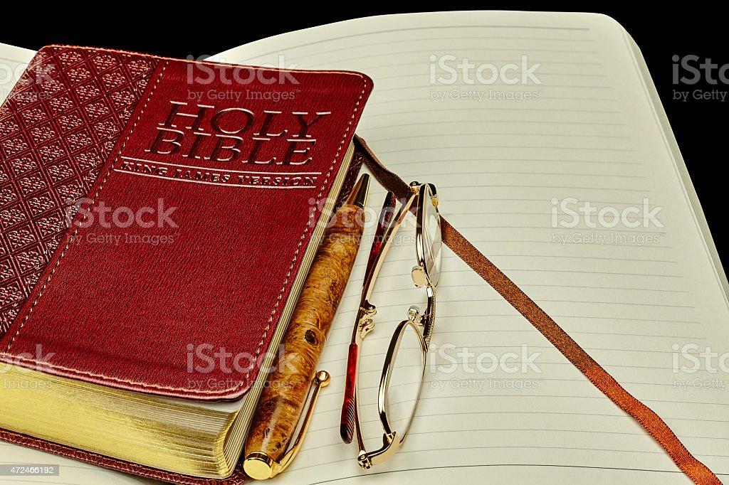 Bible personal journal pen glasses stock photo