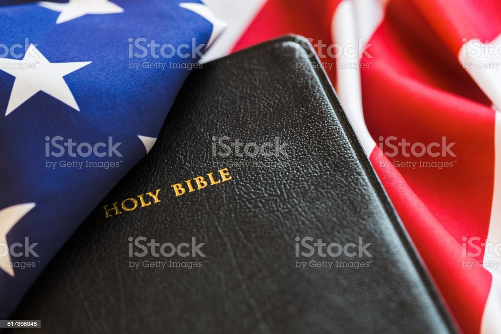 Holy Bible book on american flag background