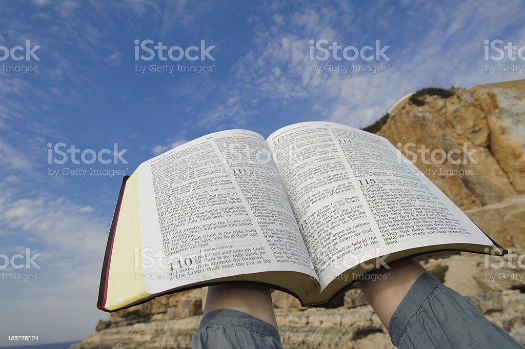 Bible raised to heaven royalty-free stock photo