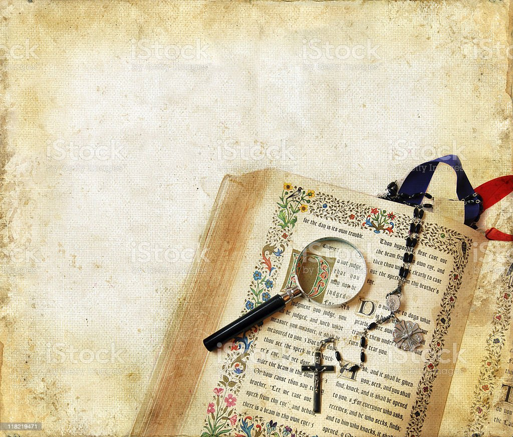 Bible, Rosary, and Magnifying Glass on a Grunge Background royalty-free stock photo
