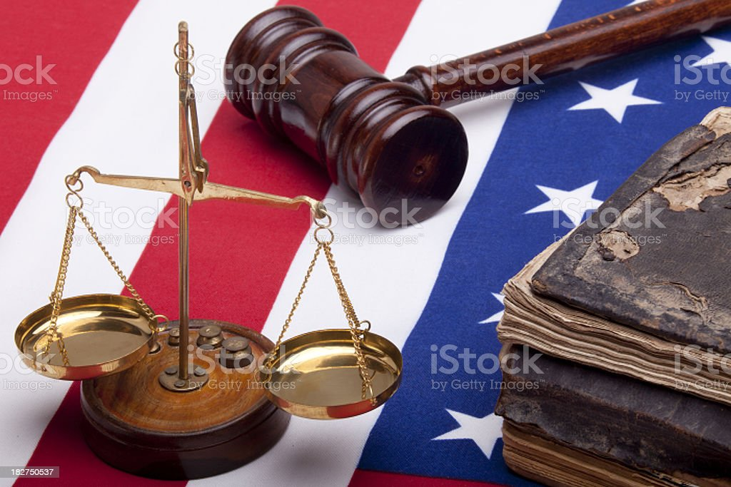 Bible, scales of justice and American Flag on white background royalty-free stock photo