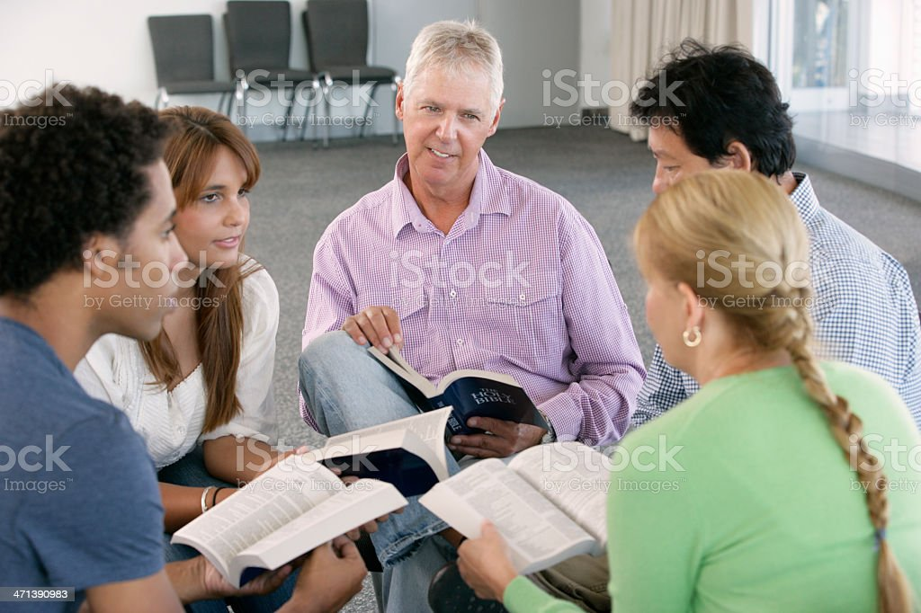 Bible study group sitting in a circle stock photo