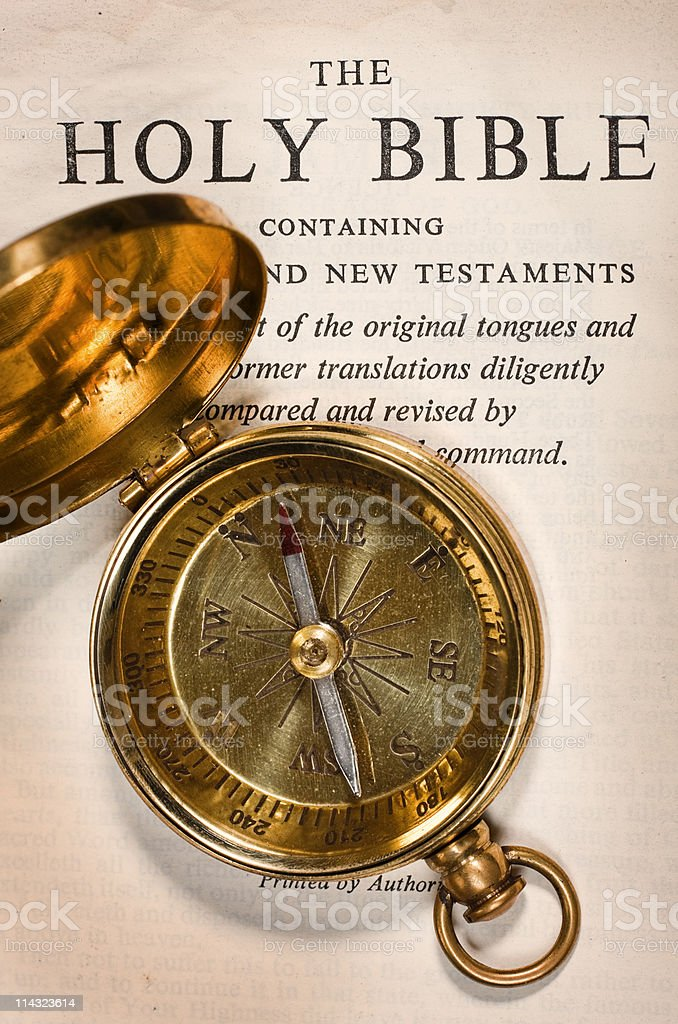 Bible with brass compass royalty-free stock photo