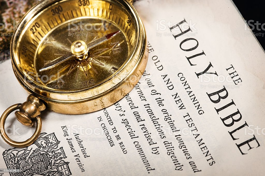 Bible with brass compass stock photo