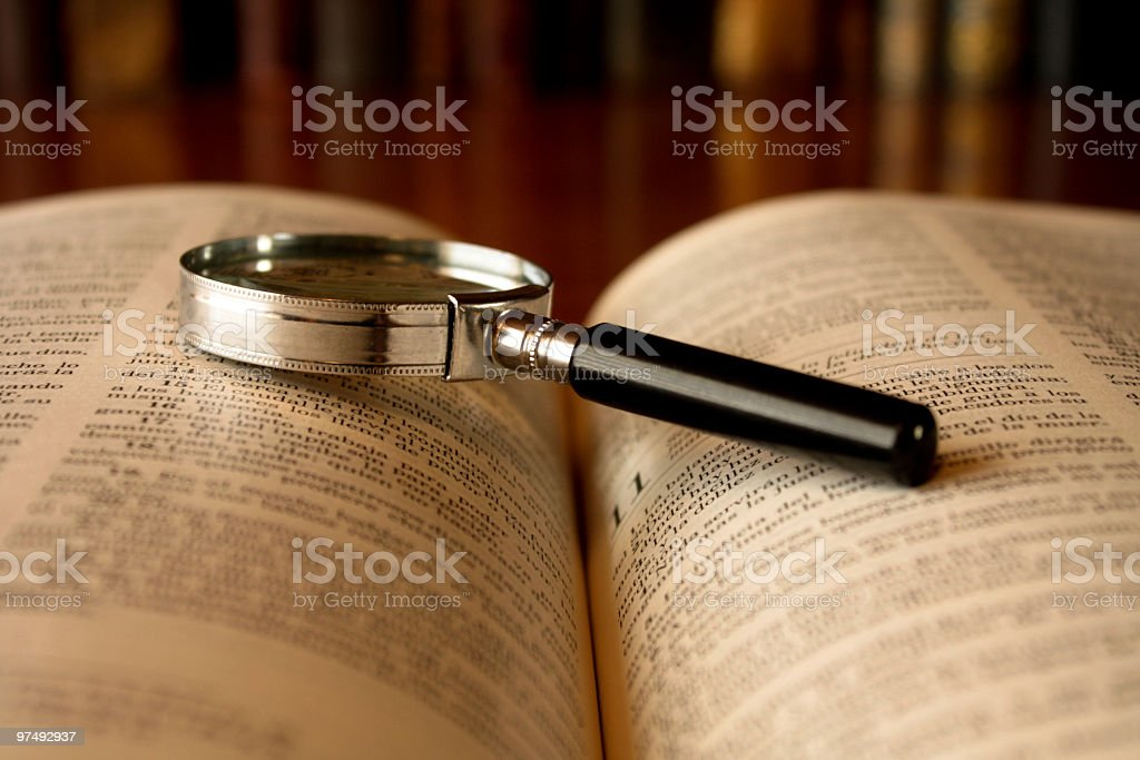 Bible with magnifying glass royalty-free stock photo