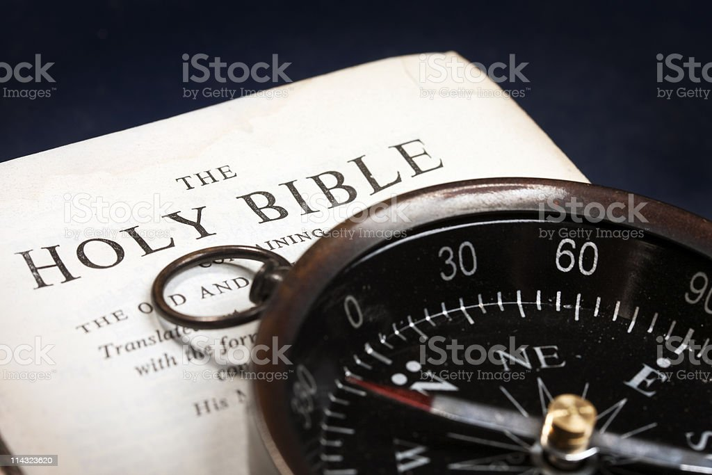 Bible with retro compass stock photo